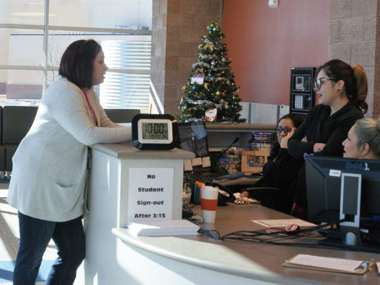 Deming High Principal Marlene Padron talks to staff at the DHS front office just before Christmas break.