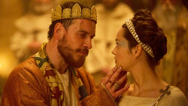 "Michael Fassbender (left) as Macbeth and Marion Cotillard as Lady Macbeth in a scene from the film ""Macbeth."""