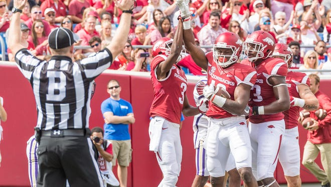 In this file photo, Arkansas wide receiver La'Michael Pettway (16) celebrates a touchdown during a game between the Razorbacks and the Alcorn State Braves in Little Rock.