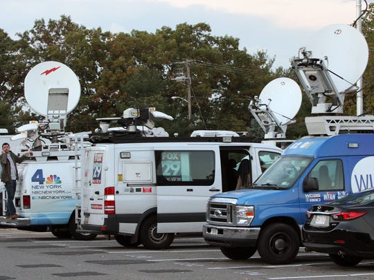 Media outlets gathered outside Sayreville War Memorial High School in October 2014 when a hazing scandal generated national headlines.