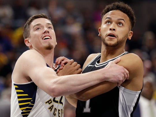 Indiana Pacers forward T.J. Leaf (22) and San Antonio Spurs guard Kyle Anderson (1) fight for position under the basket during their game at Bankers Life Fieldhouse Sunday, Oct. 29, 2017. The Indiana Pacers defeated the San Antonio Spurs 97-94.