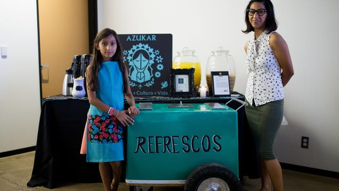 Sandra Flores (right) at the ASU Prepped Showcase at New City Church. Flores opened a coffee shop, Azukar, after completing the free program.