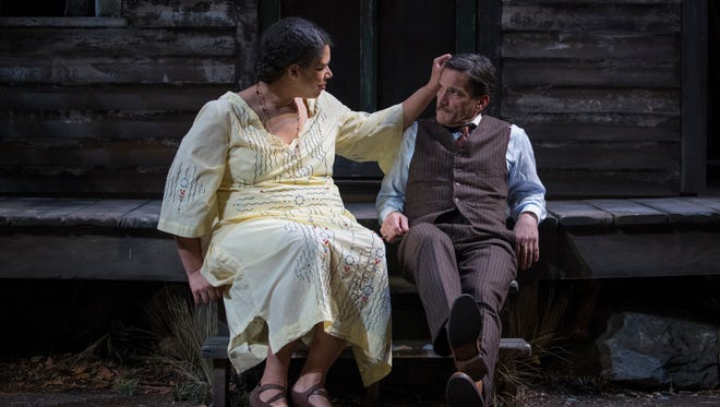 """Bethany Thomas and Jim DeVita share a gentle moment in """"A Moon for the Misbegotten."""""""