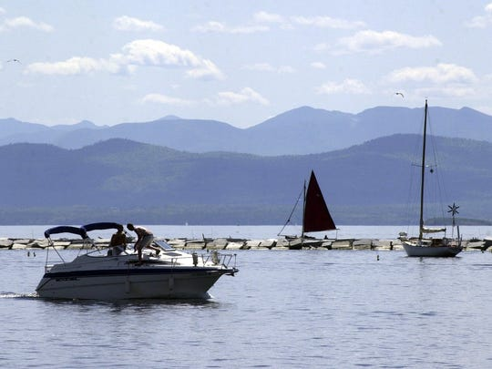 Light boat traffic plies Lake Champlain along the Burlington breakwater in this file photograph.