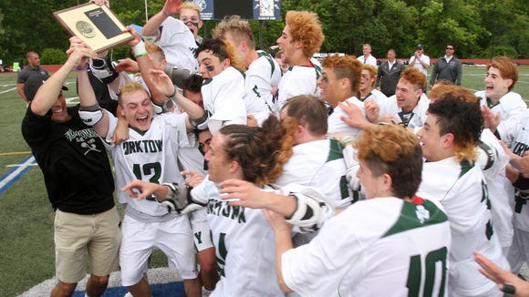 Yorktown players celebrate after defeating John Jay 14-6 to win the Section 1 Class B boys lacrosse championship at Mahopac High School May 26, 2017
