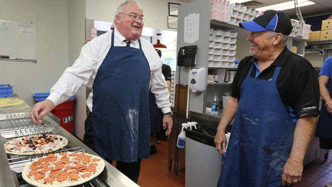 U.S. Rep. Billy Long, left, jokes with Domino''s Pizza franchisee Marty Prather at Domino's in Bolivar on Tuesday. Long's visit was in support of The Common Sense Nutrition Disclosure Act.