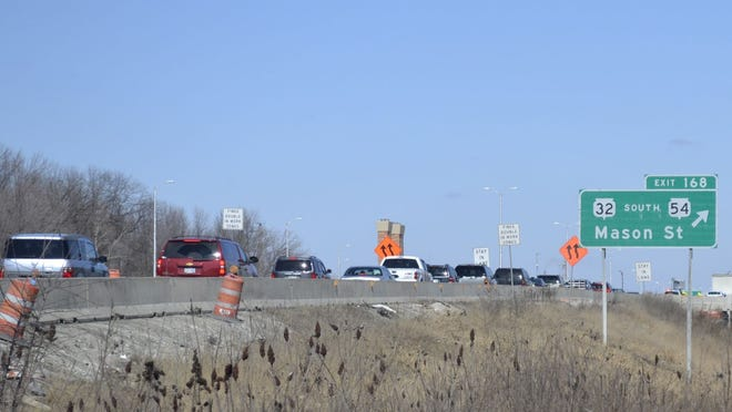 Traffic is backed up on northbound U.S. 41 in Green Bay as motorists approach the scene of a multi-vehicle accident on the highway south of Mason Street in the early afternoon Saturday, March 28.