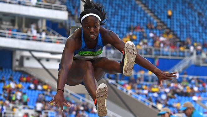 Christina Epps of Morristown competes in the triple jump qualifying round at the Olympic Games