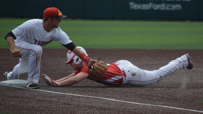 Anson third baseman Brehnen Mitchell tries to haul in a throw as Albany designated hitter Nolan Davis slides into third base during Albany's 10-0 win in Game 2 of a best-of-three Region I-2A quarterfinal series Saturday at Abilene Christian University's Crutcher Scott Field.