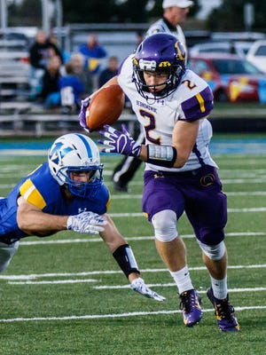 Oconomowoc wide receiver Luke Hernbrode (2) spins out of a tackle during the game at Mukwonago on Friday, Sept. 8, 2017.