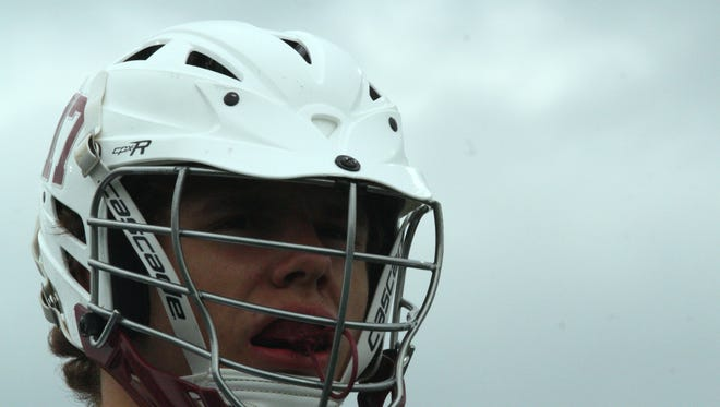 Turpin co-captain Nate Hooper leads the Spartans against Bellbrook on April 22, 2017.