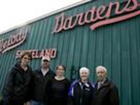 Deb Dietel, from left, Dennis Schmidt, Margie Schmidt, Gladys Brock and Alvin Brock pose outside of Melody Gardens in Marshfield. The family-owned business has been open over 40 years.