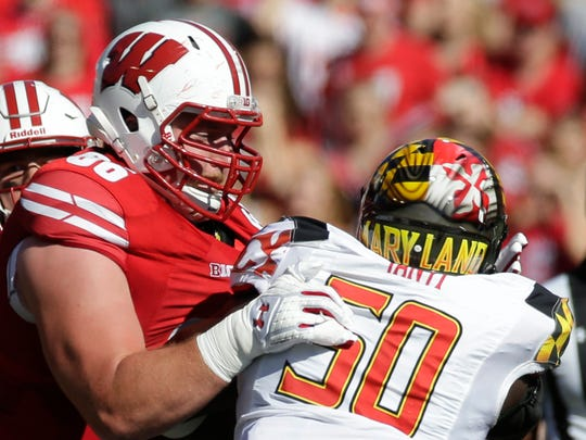 Wisconsin offensive lineman Beau Benzschawel blocks Maryland defensive lineman Mbi Tanyi during the second quarter on Saturday in Madison.
