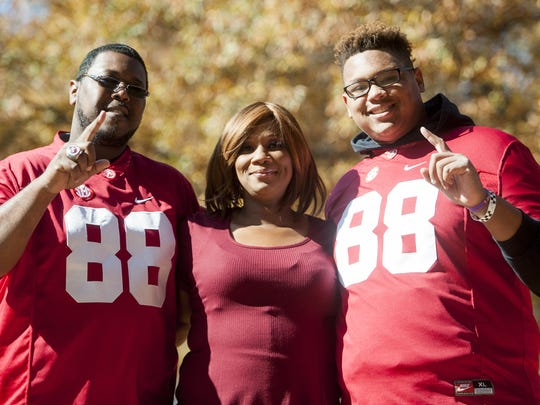 Mickey Welsh/Advertiser The family of O.J. Howard, from left, Kareem Howard, Lamesa Parker-Howard and KJ Howard, pose for a photo before the Iron Bowl at Bryant-Denny Stadium in Tuscaloosa on Saturday. The family of OJ Howard, from left, Kareem Howard, Lamesa Parker Howard and KJ Howard before the Iron Bowl at Bryant Denny Stadium in Tuscaloosa, Ala. on Saturday November 26, 2016. (Mickey Welsh / Montgomery Advertiser)