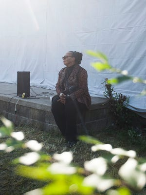 Rhea McCauley, family member of Rosa Parks, listens to a speaker at an event outside of Rosa Parks' old home in Detroit on Sunday, Sept. 25, 2016.