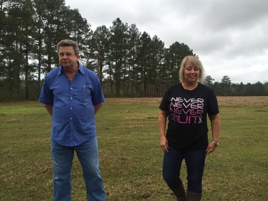 Tim and Darlene Delaney stand in a field where the Grant Parish Sheriff's Office demonstrated the drone they helped buy. Tim Delaney's father, Jim Delaney, disappeared four years ago. He said having the drone might help other families avoid their situation.
