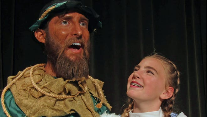 "Matt Davis as the Scarecrow sings a song to Dorothy, played by Ava Wolfenkoehler, as part of ""The Wizard of Oz Fractured,"" which opens June 8 at Surfside Playhouse."