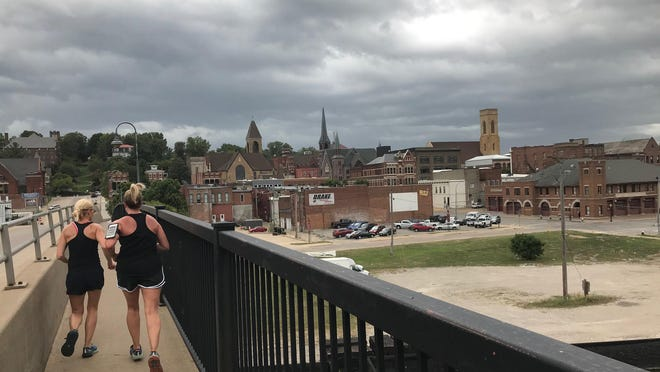 Two women out for a walk were caught outside Monday when the windy weather blew into Burlington. They were hustling to make it back to their cars.