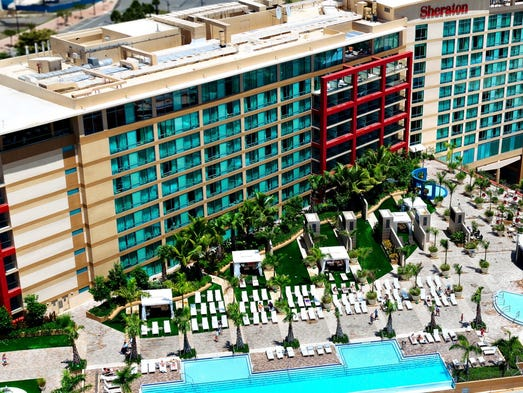 Caribbean resort pools almost as good as the beaches for 5 paws hotel and salon puerto rico