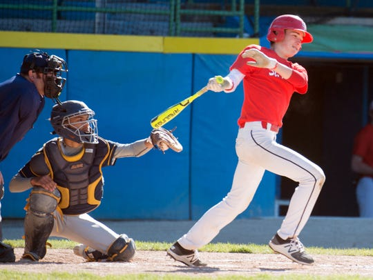St. Philip's Conor Gausselin (5) at bat.