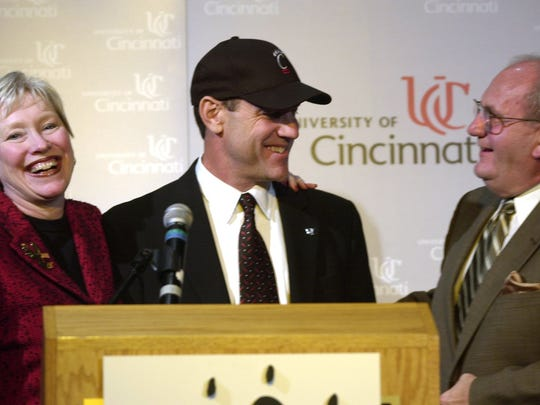 University of Cincinnati President (left) Nancy L. Zimpher and (right) Director of Athletics Bob Goin introduce new head football coach Mark Dantonio, presently the defensive coordinator of Ohio State University during a press conference on Dec. 23, 2003.