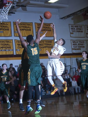 Robert Tindley of Haddon Heights floats a shot over  Audubon's Quitay Long during the second half of Tuesday's game.