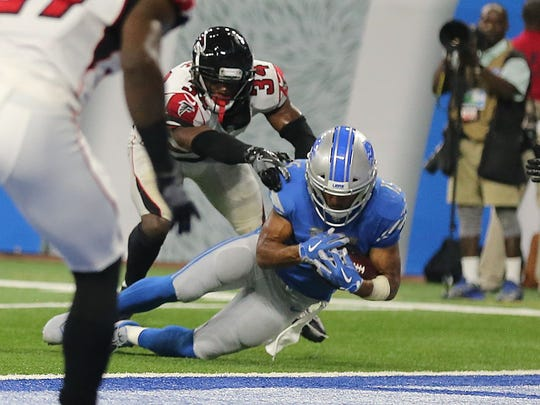Golden Tate scores a touchdown on the final play of a game against the Falcons on Sept. 24, 2017. Officials overturned the call after review, giving the Falcons a 30-26 win.
