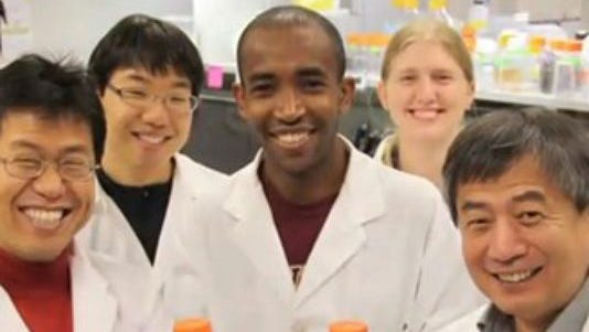 Dong-Pyou Han, right front, resigned from Iowa State University last fall after admitting he committed research fraud. Officials have said his supervisor, Michael Cho, front left, was not at fault.