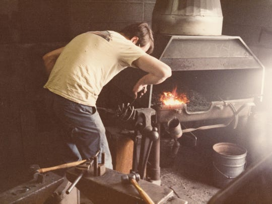 Reed Hampton, one of the company founders, seen at Hubbardton Forge in the early years.