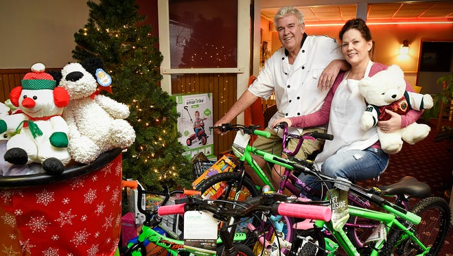 Charlie and Candace Peterka of Charlie's Pizza get ready Monday, Dec. 21 for their annual free Christmas Day meal at their restaurant in Little Falls. The Peterkas are also collecting toy and bikes to give away to children.