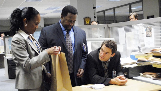 "Sonja Sohn, from left, Wendell Pierce and Dominic West appear in a scene from the HBO Peabody-winning series ""The Wire."" (Gannett News Service, Nicole Rivelli/HBO/File)"