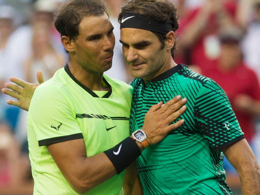 Roger Federer, of Switzerland, at right, hugs Rafael