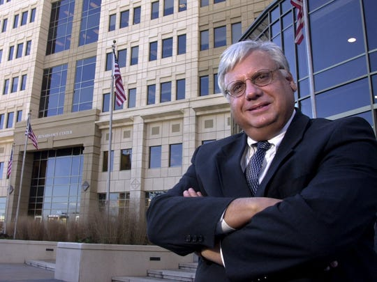 Butler County Commissioner Mike Fox, posed in front of the new Renaissance Center and the adjoining Butler County Government Service Center Thursday December 20, 2001 in Hamilton, Ohio.