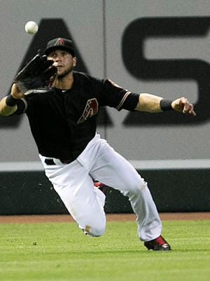 Diamondbacks outfielder David Peralta makes a catch during the third inning of a game against the Mets at Chase Field in Phoenix on Saturday, June 6, 2015.