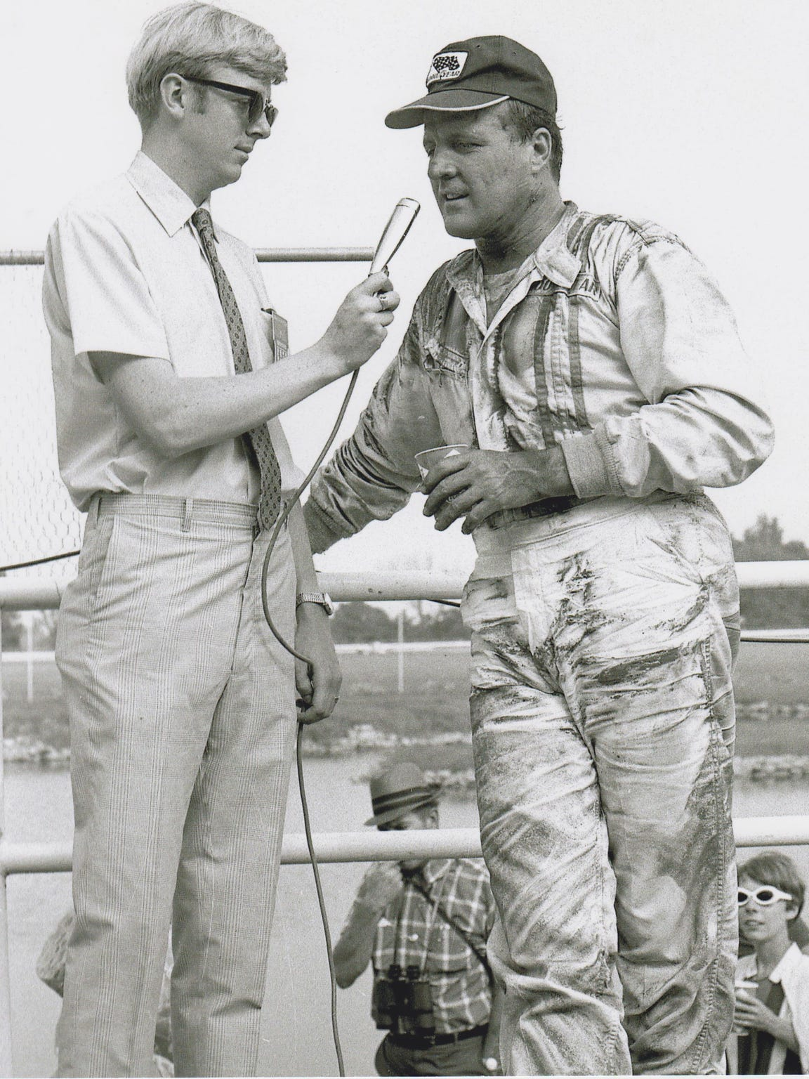 Donald Davidson, then working for the United States Auto Club, chats with four-time Indy 500 winner A.J. Foyt after a race in Illinois in 1969.