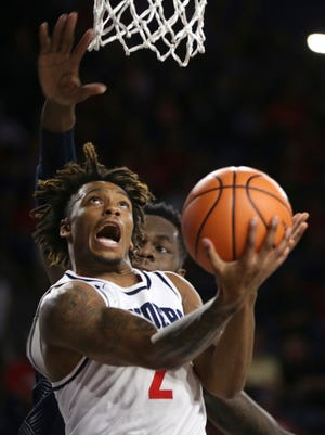FILE - In this Nov. 25, 2017, file photo, Richmond's Khwan Fore goes to the basket as Georgetown's Jessie Govan defends during an NCAA college basketball game  in Richmond, Va. Since starting the season by losing 13 of 16, the Spiders have won six of their last seven. (Shelby Lum/Richmond Times-Dispatch via AP, File)