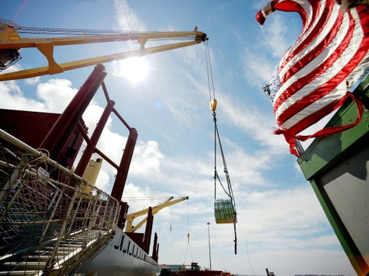 Multiple-ton coils of steel are unloaded from the cargo ship Selinda by workers on July 14, at the Logistec USA terminal at the Adm. Harold E. Shear State Pier in New London, Conn.