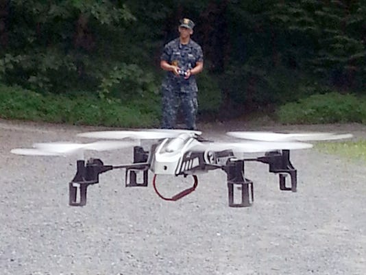 Anthony Anazagazty, Lebanon, flies a small quadcopter at the U.S. Naval Sea Cadet Corps national Advanced Training in Schaefferstown. The training focusing on STEM (science, technology, engineering, math) training, which introduced the cadets to drones.