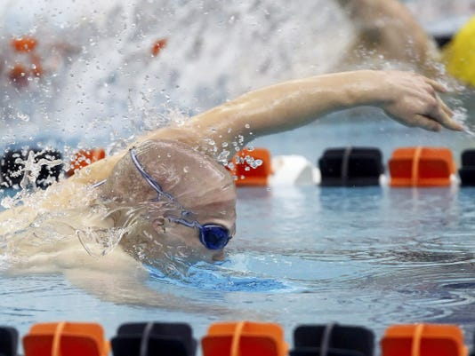 York Suburban's Matt Spinello swims the 100-yard freestyle during Thursday's PIAA Class AA boys' swimming championships at Bucknell University.