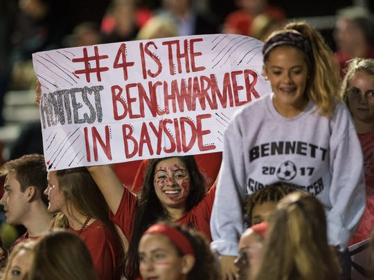 James M. Bennett fans hold signs in support of their team during a game against Parkside on Friday, Oct. 6, 2017.