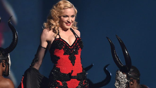 "Michigan native Madonna, looking ""Bad Blood""-esque at the Grammys this year, says her new video is ""coming soon"" to Tidal."