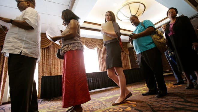 Hiring at career fairs and elsewhere has been picking up this year. (AP, Tony Dejak)