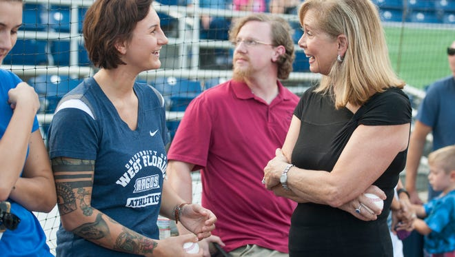 UWF senior swim star Theresa Michalak, left, who set an NCAA Division II record time Saturday,chats with Catie Condon on Aug. 4 when the two former Olympians from separate generations met at Blue Wahoos Stadium to throw out first pitches. They were honored by Blue Wahoos as resident Olympians.