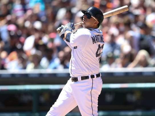 Tigers designated hitter Victor Martinez singles during