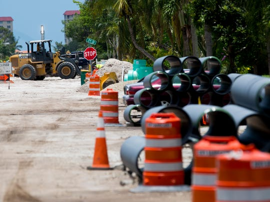 Construction along 107th Avenue in Naples Park has made it harder for runoff from heavy storms to escape, causing significant buildup Wednesday, July 12, 2017. By midday most of the water had been pumped out, but more showers were expected.