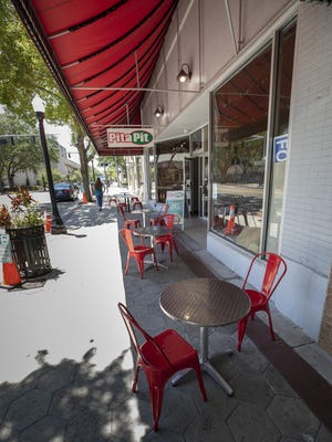 Tables outside the Pita Pit are spaced apart to keep a safe distance at the downtown Lakeland eatery.