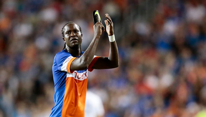 FC Cincinnati's Djiby Fall (9) claps for the fans as he leaves the game late in the second half.