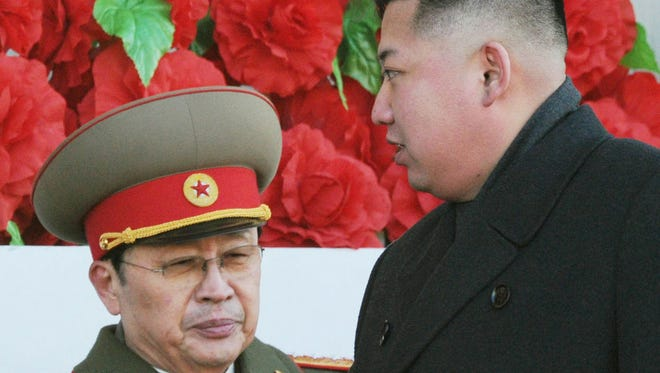 North Korean leader Kim Jong Un, right, with his uncle Jang Song Thaek reviewing a Feb. 16, 2012, parade of thousands of soldiers and commemorating the 70th birthday of the late Kim Jong Il in Pyongyang, North Korea.