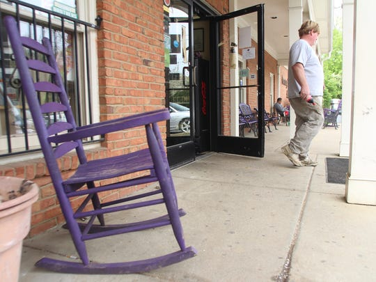 A customer walks out of the Granny White Market in Forest Hills. Also known as the Purple Cow, the market's operator Dan Smith will turn the keys over to a new tenant at the end of the month.
