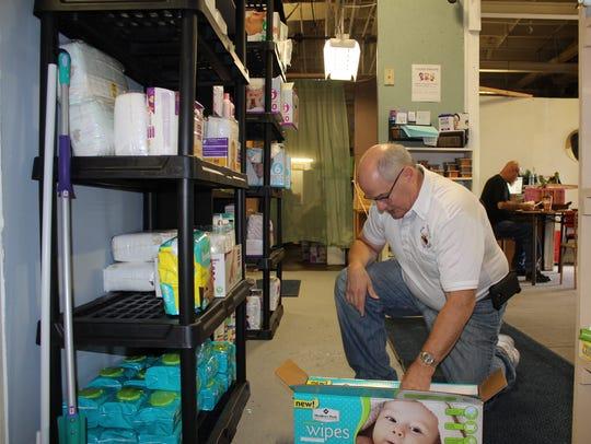 Elks member Bob Berg restocks the shelves with supplies